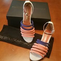 """BNIB Rebecca Minkoff Lucie Sandals Brand New. Never worn. Includes box & dust bag. There is a sharpie mark on the bottom of the right shoe where they had marked the price. Nobody will notice when you are wearing them. The rest of the shoes are in mint condition. These are a perfect staple sandal for Summer!! Size is 7, but can also fit a 7.5. This sandal features a 1.75"""" inch heel and 3.5"""" inch shaft for a supreme leg lengthening effect while showcasing an open toe. Rebecca Minkoff Shoes…"""