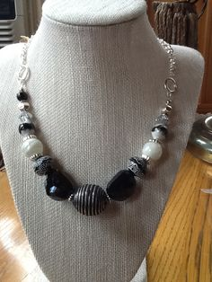 Silver chain combined with black and white acrylic and glass beads