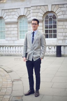 grey 1 button double breasted jacket, blue shirt navy polka dot tie, navy trousers, oxblood derby shoes