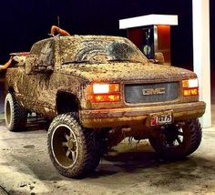lifted muddy GMC Sierra mudder truck