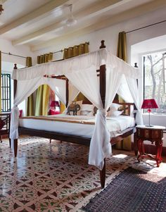 This is a lovely colonial style bedroom in Goa India.  I think this room really captures the ideal romantic tropical bedroom from the beautiful tiled floor to the inviting four poster bed.