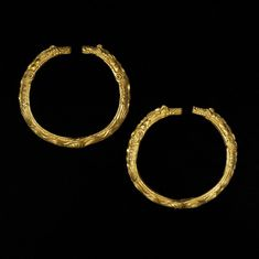 Oxus Treasure; armlet; Scythian; 5thC BC-4thC BC; Takht-i Kuwad. Gold penannular armlet; cast and chased decoration showing animals with interlocked tails while their heads form the ends; almost triangular section; in Scythian 'Animal Style'.