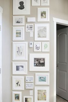 Lovely tall gallery wall to cover up outlets and thermostats.