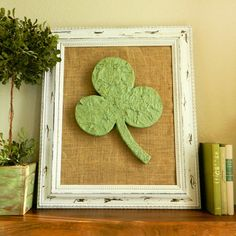 Add a little Irish flair to your decor with this DIY clover mantel decor. More St. Patty's Day decorations: http://www.bhg.com/holidays/st-patricks-day/decorating/st-patricks-day-decor/?socsrc=bhgpin030413cloverdecor