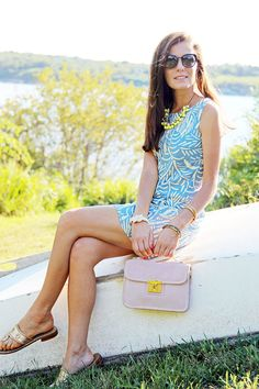 Dress by Island Company, bag by Tory Burch, sandals by Jack Rogers. (August 5, 2013)