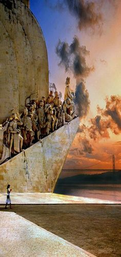 Sunset at the Monument to the Discoveries in Lisbon Portugal. The Monument honors Portuguese discoveries and the main figure is Don Henrique a Portuguese prince.