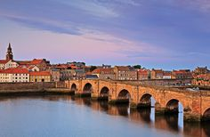"Town, Old Bridge, and River Tweed, Berwick-upon-Tweed, England, UK  Early evening shot of Berwick-upon-Tweed and the Old Bridge. Pronounced ""Berrick,"" this picturesque village near the Scottish border was my point of departure for the Northumberland Coast Walk.  All Photos © Efraín M. Padró"