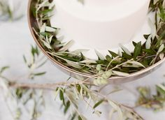 White Wedding Cake Olives Branches Greek Inspiration Table Scape