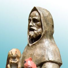 """St. Francis and Friends 32"""" - Saint Francis and Friends Bird Feeder/Bird Bath is from the Feathered Garden inspirational collection. This St. Francis statue is cast from a real wood carving for an authentic wood look. It is both functional and beautiful and is built to compliment outdoor living with feathered friends. Item # 97903 Price: $129.00 Weight 7 lbs. Materials Polyresin Dimensions 31""""H x10""""Wx 11""""L Christmas Yard, Christmas Night, Dog Garden Statues, Life Size Statues, Saint Francis, Outdoor Christmas Decorations, Toy Soldiers, Real Wood, Wood Carving"""