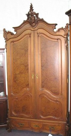 Austrian Walnut Armoire - this is sooo beautiful with cherub in top carving...Morris Antiques