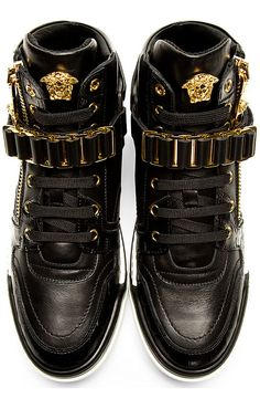Buffed leather high-top sneakers in black. Gold-tone hardware. Round toe. Tonal lace-up closure. 3D medusa appliqué at tongue. Designed by Versace. http://www.zocko.com/z/JJXCF