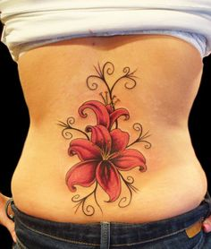 Lily Flower Tattoo - In Christianity, the lily is the symbol of chastity and purity of Virgin Mary.