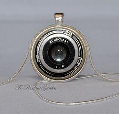 CAMERA PENDANT Vintage Camera Lens Pendant Black White Photography Jewelry Photography Necklace Camera Pendant Photographer Camera Necklace. $10.95, via Etsy.