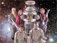 """Lost in Space .. I'm not saying it's not an awkward family photo, because it is.. Having said that, I'm enough of a nerd to also find it kinda cool. Of course, I wanted to have a soccer team called """"Enterprise D"""" and have the #1 jersey bear the name """"Riker"""" across the shoulders."""