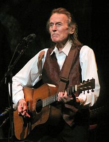 "Gordon Meredith Lightfoot, Jr.(born November 17, 1938) is a Canadian singer-songwriter who achieved international success in folk, folk-rock, and country music, and has been credited for helping define the folk-pop sound of the 1960s and 1970s. He has been referred to as Canada's greatest songwriter and internationally as a folk-rock legend.  Lightfoot's songs, including ""For Lovin' Me"", ""Early Morning Rain"", ""Steel Rail Blues"", ""Ribbon of Darkness""—a number one hit on the U.S. country…"