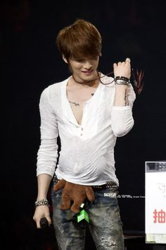 What's going on with the teddy bear tucked in his shirt o.O