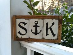 * Sign measures 11.25X6, including frame.  * Initials and anchor are made from solid 2x4 wood pieces and framed with 1x2 pine wood pieces. Custom