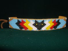 wolf bracelet, native american bracelet by deancouchie on Etsy Native Beadwork, Native American Beadwork, Beading Ideas, Beading Tutorials, Deer Hide, Bead Loom Patterns, Loom Beading, Hobby Lobby, Nativity