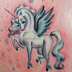 A magical unicorn pegasus in shades of turquoise and peach. The colors are much more vibrant and luscious in person!