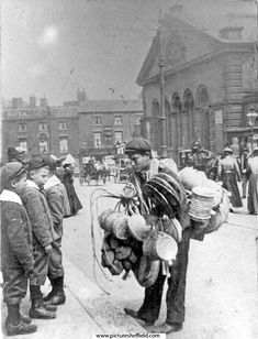 Basket Seller, Haymarket, Norfolk Market Hall (prior to the rebuilding of the west front 1904-5) and Royal Hotel in background