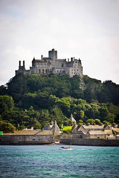 St. Michael's Mount near Penzance occupies a granite outcrop which rises dramatically from Mount's Bay and is England's most scenic coastal attraction, a medieval castle with sub tropical hanging gardens and a church perched on top of a rocky island, cut off from the mainland at high tide.