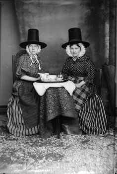 Two women in Welsh National costume drinking tea 1875.
