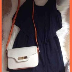 😍⤵️ Structured Tangerine/White CrossBody Gorgeous structured tangerine & white CrossBody. Gold hardware. Adjustable strap. Interior features 3 pockets. Snap closure. NWT Bags Crossbody Bags