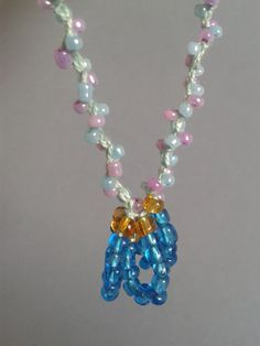 Necklace crocheted with beads
