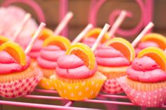Pink lemonade cupcakes - Lemon slice candies accent the pink and yellow cupcakes.