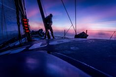 October 15, 2014. Leg 1 onboard Team Vestas Wind: Tom Johnson climbs the rig before the sunset to see if we still have a VHF aerial on the mast during day 4 of the Volvo Ocean Race. Brian Carlin/Team Vestas Wind/Volvo Ocean Race