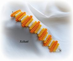Beaded yellow white orange seed bead bracelet summer by Szikati