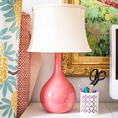 This cute coral lamp matches the owner's sofa. #decor