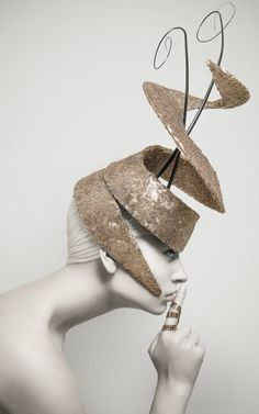 By Carrie Jenkinson Millinery Unique Futuristic Gold Blocked Fascinator/Headpiece. Curved blocked Sinamay covered with gold sequinned material and finished with 2 ostrich spines running through the centre