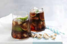 While the meat is sizzling over the fire, pass around the pistachios and partake in this much-loved cola and rum combo.