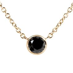 Stay updated with the latest trends in women's vogue with our bezel black-diamond necklace that is skillfully crafted in highest quality 14-karat yellow gold. Ensuring the most out of durability and a
