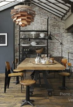 That light fixture??... But the exposed brick with the black accents I love!