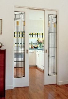 Separating the kitchen and dining rooms, these beautiful stained-glass pocket doors echo the bold Craftsman-style kitchen tiles, lending an elegant touch to both rooms. When the doors are open, the rooms function as one space, but once they're closed, the dining room becomes a more intimate setting.