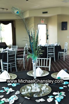Reception table decorations at star wars themed wedding at saguaro centerpieces peacock theme at saguaro buttes wedding venue in tucson az arizona by michael chansley photography junglespirit Images