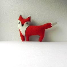 // Made to order //You choose the colors.Either as an accent pillow or plush toy, our fox would make a lovely companion. Each fox is made from reclaimed, re-purposed fulled wool clothing. No two are alike.We cut every piece by hand and sew it in our studio.Visit our ETSY STORE to view readymade pieces.http://www.etsy.com/shop/threebadseedsDomestic shipping is on us -- thank you for valuing our work.