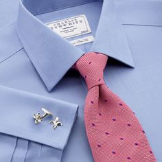 One way to make the boring blue dress shirt a little more tolerable