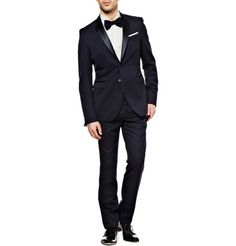 A slim fit tuxedo is a modern twist on the classic wedding day attire!