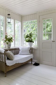 Traditional Swedish glassed porch with wooden sofa @tiinatolonen Love the porch!