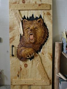 Party Crasher DoorFully carved bear (one side) secured to distressed pine door, with ext. jamb  Cost: $5,645