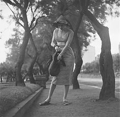 Photo by Gordon Parks, 1951 street style vintage fashion 50s knit striped casual sportswear skirt crop top flat shoes hat purse found photo print