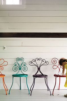 anthro wrought iron seating...refinish vintage chairs with fun colors