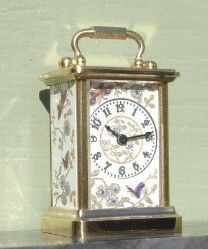 1:12 scale WORKING dolls house French carriage clock with engraved panels to three sides and the top. They are infilled with metallic paint in a brass gold plated case with polished bevelled glass to the front. : Halls Miniature Clocks
