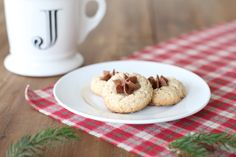 12 Days of Cookies - Pecan Thumbprint cookie recipe with chocolate buttercream icing.