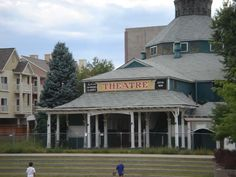 Elitch Gardens Photos. My first amusement park...Denver, CO. Check out the theatre that is still standing while building goes on around it.