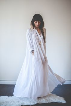 The Kundalini Gown is designed for the Aquarian Woman. All white, full length dress with side pockets to hold your crystals, button down from collar bone to ankle bone. Perfect for your Kundalini practise, meditation at home, post yoga, before and after, dress it up for a fancy occasion. Wear the Aquarian Woman lifestyle. Whatever occasion you wear it at you will feel like a goddess in this flowy adornment designed with love by Myrah Penaloza.