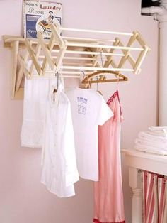 Easy Updates for a Better Laundry Room...hang a drying rack fron the wall...genius... by MyLittleCornerOfTheWorld